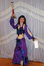 Piper poses with 1st place trophy from the Belly Dancer of the Year Competition in 2000