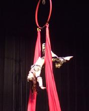 Melina performs a daring combination of Silks, Lyra, and belly dance on air 180