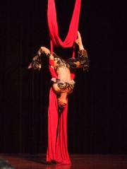Melina performs a daring combination of Silks, Lyra, and belly dance on air 171