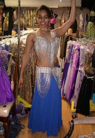 Bastet of the Baltimore Daughters of Rhea Dance Ensemble tries on a two piece silver and blue costume