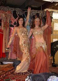 Amelia and Piper pose in costumes at Shahrzad's Belly Dance Store in Saverna Park, MD