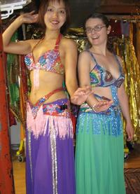 Kaoru and Rachel of the Daughters of Rhea Belly Dance Troupe in Baltimore choose costumes for Belly Dance Magic