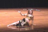 Piper's belly dance floorwork with sword balanced on head