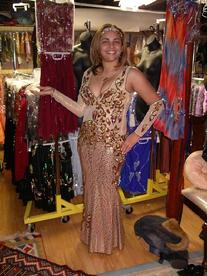 Lisa of the Baltimore Daughters of Rhea Troupe tries on a print dress