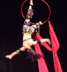 Melina performs a daring combination of Silks, Lyra, and belly dance on air 203