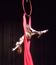 Melina performs a daring combination of Silks, Lyra, and belly dance on air 181