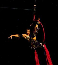 Melina performs a daring combination of Silks, Lyra, and belly dance on air 1204