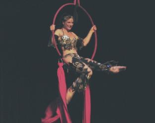Melina performs a daring combination of Silks, Lyra, and belly dance 3