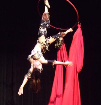 Melina performs a daring combination of Silks, Lyra, and belly dance on air 202