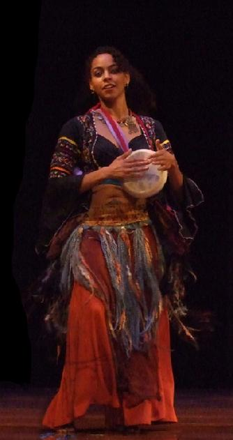 Bastet plays tabla while dancing in Rhea's Sibek choreography at Belly Dance Magic 2007