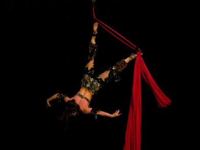 Melina performs a daring combination of Silks, Lyra, and belly dance on air 1203